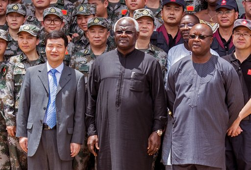 """In this file photo taken on Sept. 25, 2015, Chinese Ambassador Zhao Yanbo, left, stand next to Sierra Leone's president Ernest Bai Koroma, center, and  Sierra Leone's  Vice President Samuel Sam-Sumana,  right, during the opening ceremony of  the China Friendship Hospital catering for Ebola virus patience in Freetown, Sierra Leone. Sierra Leone's vice president sought asylum on the United States on Saturday, March 14, 2015, saying he no longer felt safe in the country after soldiers disarmed the security team at his residence. """"I don't feel safe this morning as vice president,"""" Samuel Sam-Sumana told The Associated Press by phone.  (AP Photo/Michael Duff, File)"""