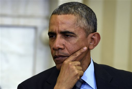 In this March 9, 2015, file photo, President Barack Obama listens during his meeting with European Council President Donald Tusk in the Oval Office of the White House in Washington. For the second consecutive year, the Obama administration more often than ever censored government files or outright denied access to them under the U.S. Freedom of Information Act, according to a new analysis of federal data by The Associated Press. (AP Photo/Susan Walsh)