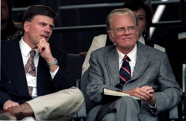 Bill Graham, right, and son Franklin Graham in 1994. (Paul M. Walsh/CC BY-SA 2.0)