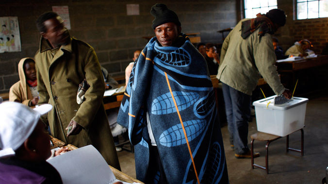 A Lesotho man prepares to vote in Maseru in 2012. Lesotho's ruling party seems to have taken the lead, but results still show the country is set to have its first ever coalition Cabinet. (Jerome Delay/AP Photo)