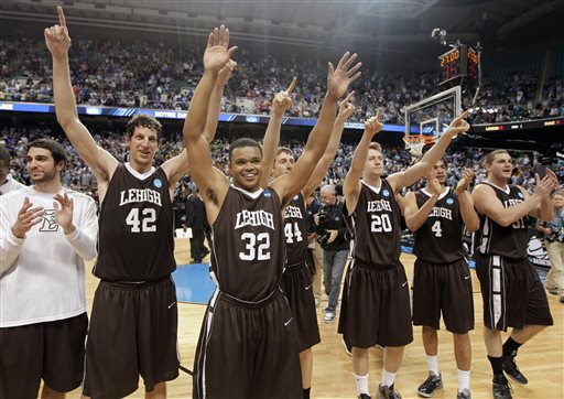 In this Friday, March 16, 2012 file photo, Lehigh's Gabe Knutson (42), B.J. Bailey (32), Jordan Hamilton (44), Holden Greiner (20), John Adams (4) and Justin Maneri (31) celebrate after winning an NCAA tournament second-round college basketball game against Duke in Greensboro, N.C.  Lehigh won 75-70. If you got that warm-'n-fuzzy feeling the weekend Lehigh beat Duke or the year N.C. State socked Phi Slama Jama or the time Butler almost did it, you are not alone. (AP Photo/Chuck Burton, File)
