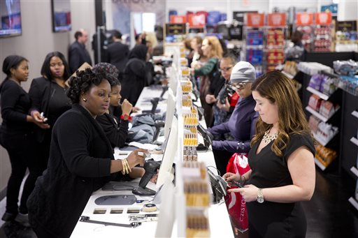 In this Oct. 28, 2014 file photo, shoppers check out at the Century 21 Department Store in Philadelphia. The Federal Reserve releases consumer credit data for January on Friday, March 6, 2015. (AP Photo/Matt Rourke, File)