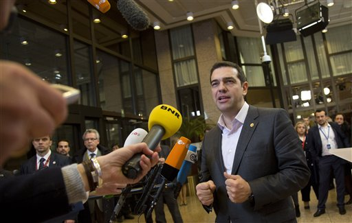 Greek Prime Minister Alexis Tsipras speaks with the media during an EU summit in Brussels on Friday, March 20, 2015. German Chancellor Angela Merkel said Thursday that Greece has no choice but to carry out economic reforms if it wants to receive more financial aid, dashing any hopes Athens might have had for a softening in Berlin's stance. (AP Photo/Virginia Mayo)