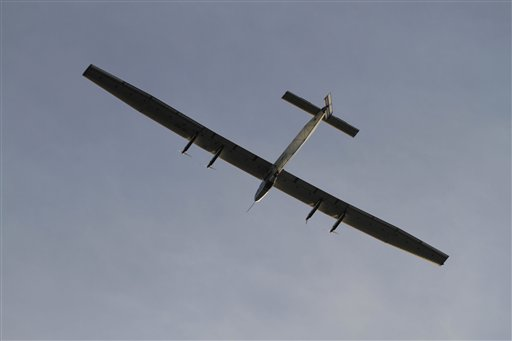 Swiss-made Solar Impulse-2 takes off from Ahmadabad, India, Wednesday, March 18, 2015. The solar powered aircraft is Wednesday headed to the northern Indian city of Varanasi on the third leg of its' historic round-the-world trip. (AP Photo/Ajit Solanki)