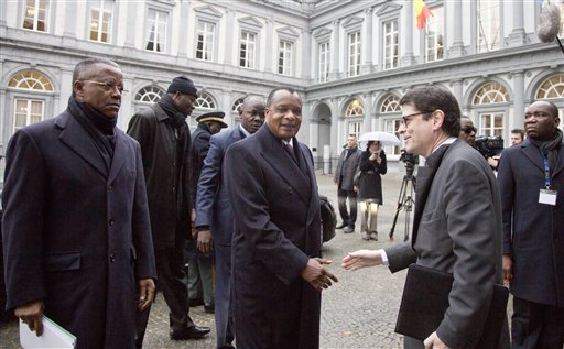 Congo President Denis Sassou Nguesso, center, arrives for a conference on Ebola at the Egmont Palace in Brussels on Tuesday, March 3, 2015. Liberia's president is calling for a Marshall Plan of international aid to help eradicate Ebola from western Africa and rebuild economies, as the number of deaths from the disease approaches 10,000. Sirleaf told fellow regional leaders and delegates at a major international conference on Ebola in Brussels that rebuilding economies devastated by the outbreak is a long-term and costly task. (AP Photo/Virginia Mayo)