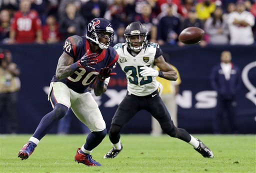 In this Dec. 28, 2014, file photo, Houston Texans wide receiver Andre Johnson (80) makes a reception as Jacksonville Jaguars cornerback Demetrius McCray (35) defends during the second half of an NFL football game in Houston. Johnson has been released by the Houston Texans, a person with knowledge of the move told The Associated Press, Monday, March 9, 2015. The person spoke on condition of anonymity because no formal announcement had been made by the team. (AP Photo/Patric Schneider, File)