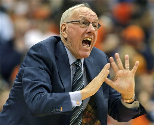 In this Dec. 6, 2014, file photo, Syracuse head coach Jim Boeheim yells to his players in the second half of an NCAA college basketball game against St. John's in Syracuse, N.Y. The NCAA has suspended Syracuse coach Jim Boeheim Friday, March 6, 2015, for nine games for academic, drug and gifts violations committed primarily by the men's basketball program.(AP Photo/Nick Lisi, File)