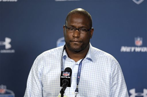 FILE - In this Feb. 19, 2015, file photo, Cleveland Browns general manager Ray Farmer listens to a question during a news conference at the NFL football scouting combine in Indianapolis. The NFL has suspended Browns general manager Ray Farmer for four games for sending text messages to the sideline last season during games.  Farmer has acknowledged sending the messages, which is prohibited under league rules. The league's punishment handed down on Monday, March 30, 2015,  includes a $250,000 fine on the Browns.  (AP Photo/David J. Phillip, File)