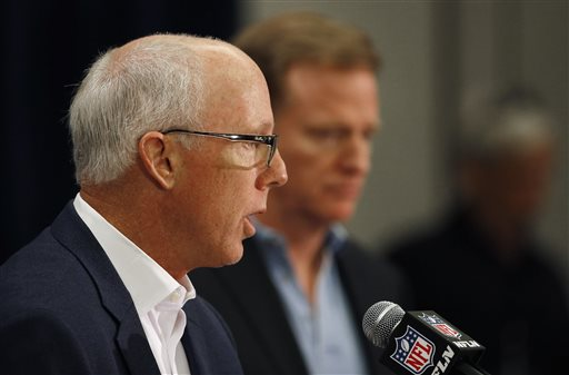 NFL competition committee chairman Rich McKay, left, who is also the Atlanta Falcons president and CEO, address the media to give a final report on the rules changes, as NFL Commissioner Roger Goodell listens in at a news conference during the NFL Annual Meeting Wednesday, March 25, 2015, in Phoenix. (AP Photo/Ross D. Franklin)