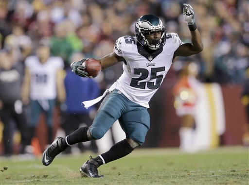 In this Dec. 20, 2014, file photo, Philadelphia Eagles running back LeSean McCoy carries the ball during an NFL football game against the Washington Redskins in Landover, Md. A person familiar with the deal says the Eagles have agreed to trade star running back McCoy for Buffalo Bills linebacker Kiko Alonso. The person spoke under condition of anonymity Tuesday night, March 3, 2015, because the teams had not announced the deal. (AP Photo/Patrick Semansky, File)