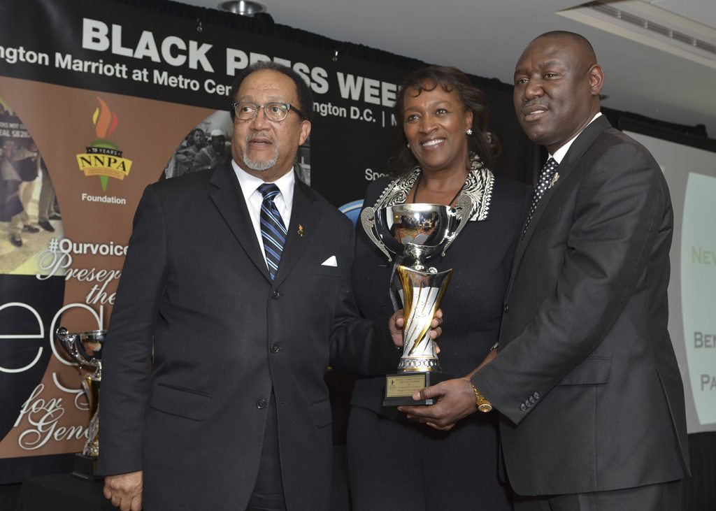 NNPA President and CEO Benjamin F. Chavis, Jr. (left) and Publisher Natalie Cole present Newsmaker of the Year award to Attorney Ben Crump (NNPA Photo by Freddie Allen)