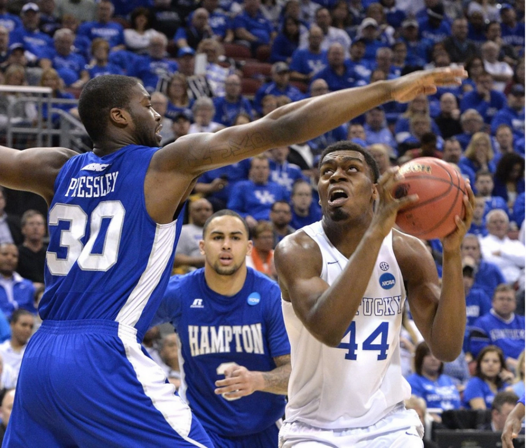 Hampton's 6-foot-8 Jervon Pressley, left, does his best to defend Kentucky 7-footer Dakari Johnson. (Timothy D. Easley/Associated Press)