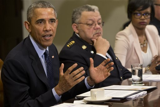 President Barack Obama speaks during a meeting with members of the Task Force on 21st Century Policing, Monday, March 2, 2015, in the Roosevelt Room of the White House in Washington. From left are, the president, Philadelphia Police Commissioner Charles Ramsey, and Brittany Packnett, executive director of Teach For America in St. Louis, Missouri. (AP Photo/Jacquelyn Martin)