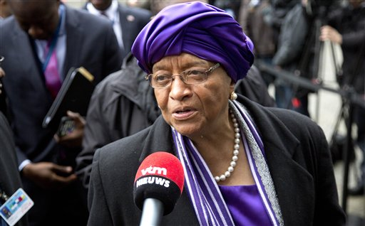 Liberian President Ellen Johnson Sirleaf speaks with the media as she arrives for a conference on Ebola at the Egmont Palace in Brussels on Tuesday, March 3, 2015. Liberia's president is calling for a Marshall Plan of international aid to help eradicate Ebola from western Africa and rebuild economies, as the number of deaths from the disease approaches 10,000. Sirleaf told fellow regional leaders and delegates at a major international conference on Ebola in Brussels that rebuilding economies devastated by the outbreak is a long-term and costly task. (AP Photo/Virginia Mayo)