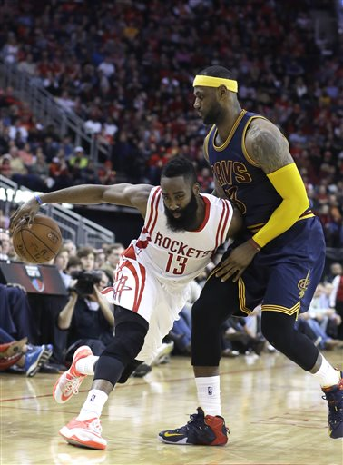 Houston Rockets' James Harden (13) pushes against Cleveland Cavaliers' LeBron James (23) in the second half of an NBA basketball game Sunday, March 1, 2015, in Houston. The Rockets won 105-103 in overtime. (AP Photo/Pat Sullivan)