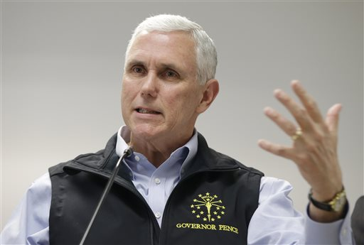 Indiana Gov. Mike Pence responds to a question during a news conference Wednesday, March 25, 2015, in Scottsburg, Ind. Pence held a news conference after meeting with local officials in Scott County about an HIV outbreak. (AP Photo/Darron Cummings)