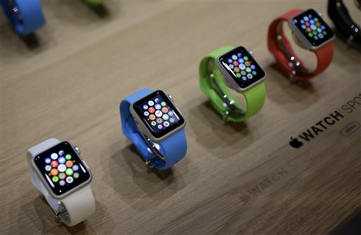 Varieties of the new Apple Watch are on display in the demo room after an Apple event on Monday, March 9, 2015, in San Francisco. Pre-orders for the Apple Watch start April 10. The device costs $349 for a base model, while a luxury gold version will go for $10,000. (AP Photo/Eric Risberg)