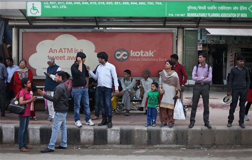 "Indians wait for a bus at the bus stop where the victim of a deadly gang rape had boarded on Dec. 16, 2012, in New Delhi, India, Wednesday, March 4, 2015. When one of the four men sentenced to death for the high-profile gang rape of the woman in 2012 was quoted in a new documentary as saying ""a girl is far more responsible for rape than a boy,"" he was repeating something community and religious leaders in this nation of 1.2 billion routinely say. Mukesh Singh, who was driving the bus for much of the time that the 23-year-old woman was being attacked, told the documentary film maker that the victim should have remained silent and allowed the rape, and that they would have spared her life. (AP Photo/Altaf Qadri)"