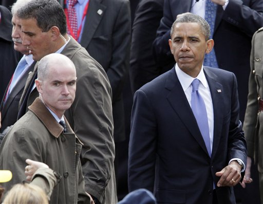 In this May 23, 2011 file photo, President Barack Obama pauses as he shakes hands with people in the crowd after speaking at College Green in Dublin, Ireland.  Mark Connolly, the second-in-command on President Barack Obama's security detail, far left.  The Homeland Security Department is investigating two senior Secret Service agents accused of crashing a car into a White House security barrier, an agency spokesman says. (AP Photo/Carolyn Kaster)