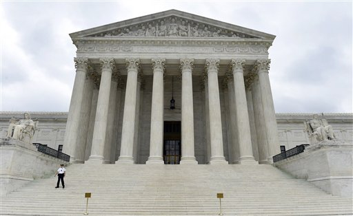 In this Oct. 3, 2014 file photo, the Supreme Court is seen in Washington. Americans' confidence in all three branches of government is at or near record lows, according to a long-running and widely respected survey that's measured Americans' attitudes on the subject over the last 40 years. The 2014 General Social Survey finds only 23 percent of Americans have a great deal of confidence in the Supreme Court, 11 percent in the executive branch and only 5 percent have a lot of confidence in Congress. By contrast, half have a great deal of confidence in the military. (AP Photo/Susan Walsh, File)