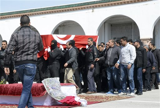 Tunisian police officers carry the coffin of elite security member Aymen Morjen, Thursday March 19, 2015 in Tunis. Morjen was killed in the Wednesday attack at the Bardo National museum. The Islamic State group issued a statement Thursday claiming responsibility for the deadly attack on Tunisia's national museum that killed 23 people, mostly tourists. (AP Photo/Khazri)