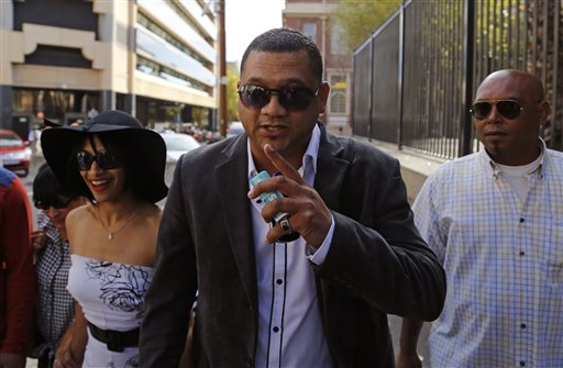 In this Friday March 6, 2015 file photo, Morne Nurse, center, the father of a girl that was kidnapped as a baby 17 years ago, and his wife Celeste Nurse, left, arrive at court for the appearance of a woman suspected of the kidnapping in Cape Town, South Africa. Morne Nurse, who was reunited with his kidnapped daughter after 17 years said on Tuesday March 10, 2015, that he would like to talk to Madeleine McCann's parents. (AP Photo/Schalk van Zuydam, File)