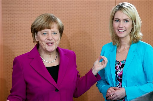In this June 4, 2014 file photo German Chancellor Angela Merkel and Minister for Family Affairs Manuela Schwesig, from left, attend a cabinet meeting at the chancellery in Berlin, Germany. Germany's Parliament has approved a quota system that will require leading companies in Europe's biggest economy to have at least 30 percent women on their supervisory boards starting next year. Lawmakers from Merkel's governing coalition backed the legislation Friday, March 6, 2015, while opposition lawmakers who argued that it didn't go far enough abstained. (AP Photo/dpa, Maurizio Gambarini, File)