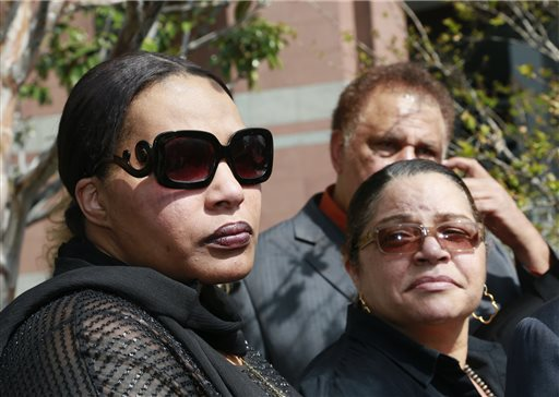 "In this Tuesday, March 10, 2015 file photo, Marvin Gaye's daughter, Nona Gaye, left, and his ex-wife, Janis Gaye, take questions from the media outside Los Angeles U.S. District Court, after a jury awarded the singer's children nearly $7.4 million after determining singers Robin Thicke and Pharrell Williams copied their father's music to create ""Blurred Lines."" Marvin Gaye's family is seeking to stop the distribution of ""Blurred Lines."" Gaye's children filed a motion in court Tuesday, March 17, 2015, to prevent the copying, distributing and performing of the hit song featuring Pharrell, Robin Thicke and T.I.  (AP Photo/Nick Ut, File)"