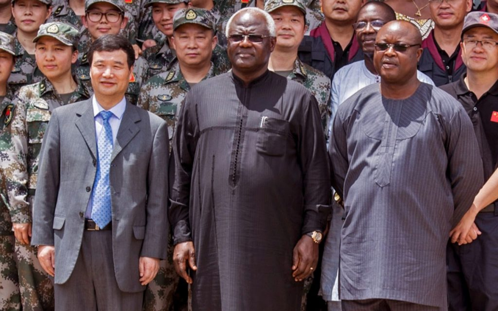 In this file photo, Sierra Leone's Vice President Samuel Sam-Sumana (center) attends the opening ceremony of the China Friendship Hospital catering to Ebola virus patience in Freetown, Sierra Leone. (Michael Duff/AP Photo)