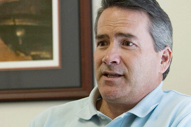 In this Aug. 2, 2010 photo, Jody Hice, a republican U.S. congressional candidate for Georgia's seventh district, is interviewed in his campaign headquarters where a rendering of Jesus with his hand over the crack in the Liberty Bell hangs, in Lawrenceville, Ga.  The Southern Baptist minister has spent years challenging legal barriers separating church and state. (AP Photo/John Amis)