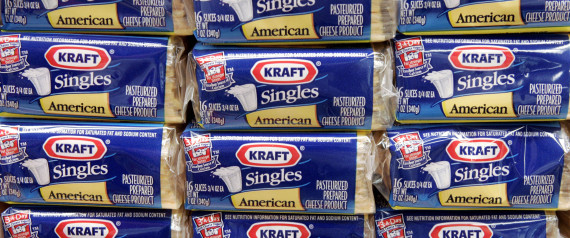 Packages of Kraft Singles are seen in this July 24, 2006 file photo, in Chicago.  Kraft Foods Inc., the nation's largest food and beverage maker, reported a second-quarter profit rise of nearly 4 percent on Monday, July 28, 2008, saying higher prices helped offset rising commodity costs. (AP Photo/Charles Rex Arbogast, file)