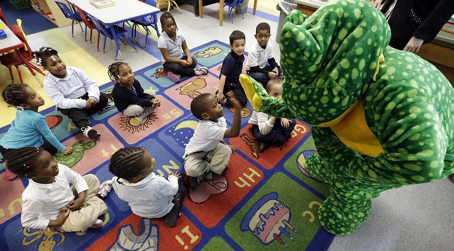 Ready Freddy visits prekindergarten students at a public school in Buffalo, N.Y. (David Duprey/AP Photo)