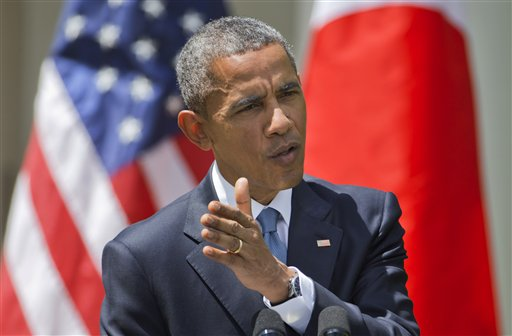 President Barack Obama speaks about recent unrest in Baltimore during a joint news conference with Japanese Prime Minister Shinzo Abe, Tuesday, April 28, 2015, in the Rose Garden of the White House in Washington. (AP Photo/Jacquelyn Martin)