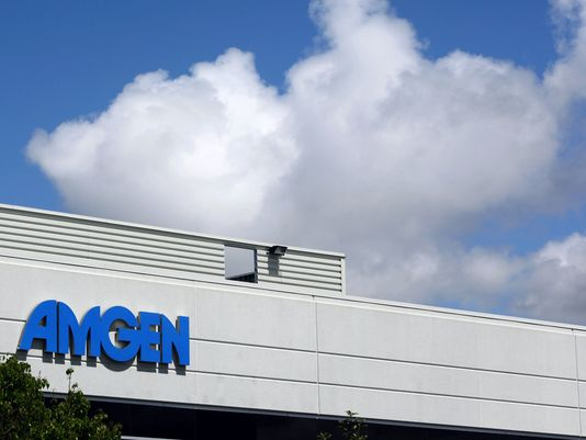 This April 20, 2010, file photo, shows an exterior view of Amgen offices in Fremont, Calif. Biotech drugmaker Amgen Inc. reports quarterly earnings on Tuesday, July 29, 2014. (AP Photo/Paul Sakuma)