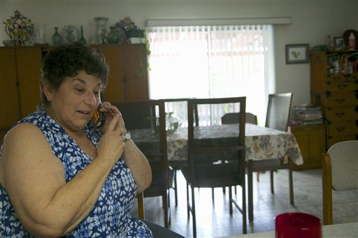 "In this photo taken April 3, 2015, Jeri Vargas takes a phone call at her mother's home in the Sherman Oaks area of Los Angeles. Jeri Vargas put her elderly mother on the ""Do Not Call"" list years ago. So why is the 88-year-old woman with Alzheimer's disease still getting several recorded phone calls a day pitching her everything from vacation cruises to medical alert devices and fire extinguishers? (AP Photo/Damian Dovarganes)"