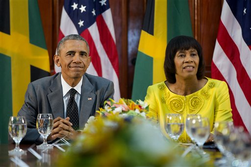 US President Barack Obama and Jamaican Prime Minister Portia Simpson-Miller during their bilateral meeting at the Jamaica House, Thursday, April 9, 2015, in Kingston, Jamaica. The president said Thursday that he soon decide whether to remove Cuba from the U.S. list of state sponsors of terrorism now that the State Department has finished a review on the question as part of the move to reopen diplomatic relations with the island nation. (AP Photo/Pablo Martinez Monsivais)