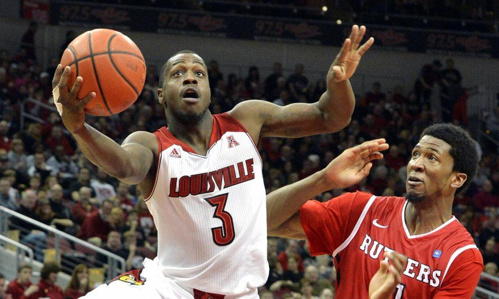 Louisville's Chris Jones, left, drives past Rutgers' Kadeem Jack during an NCAA college basketball game in Louisville, Kentucky. Photograph: (Timothy D. Easley/AP Photo)