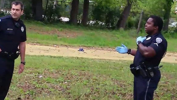 Officer Clarence Habersham, right, stands over Walter Scott with Michael Slager. (Screengrab from eyewitness Feidin Santana's video)