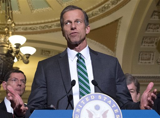 In this March 17, 2015 file photo, Sen. John Thune, R-S.D. speaks to reporters on Capitol Hill in Washington. The federal estate tax inspires a lot of heated political rhetoric for a tax that very few people actually pay. The House is scheduled to vote this week on a bill to repeal the estate tax, part of a package of bills highlighting Wednesday's deadline to file income tax returns. Thune is the sponsor of a Senate bill repealing the estate tax. (AP Photo/Molly Riley, File)
