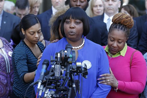 Ursula Ward, mother of shooting victim Odin Lloyd, is comforted by family and friends outside Bristol County Superior Court Wednesday, April 15, 2015, in Fall River, Mass., after former New England Patriots football player Aaron Hernandez was found guilty of murder in the shooting death of Lloyd. (AP Photo/Stew Milne)