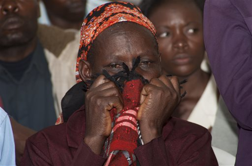 A woman sobs into her scarf after she viewed the body of a relative killed in last Thursday's attack on Garissa University College in northeastern Kenya, at Chiromo funeral home, Nairobi, Kenya, Wednesday, April 8, 2015. Al-Shabab gunmen rampaged through the university at dawn Thursday, killing over 140 people in the group's deadliest attack in the East African country. Four militants were slain by security forces to end the siege just after dusk. (AP Photo/Sayyid Azim)