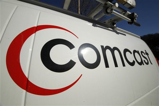 This Feb. 11, 2011 file photo shows the Comcast logo on one of the company's vehicles, in Pittsburgh. Wall Street appears increasingly convinced Comcast's $45.2 billion purchase of Time Warner Cable is dead.  telling indicator is the gap between the value Comcast's all-stock bid assigned to each Time Warner Cable share and Time Warner Cable stock's current price. That was at its widest point yet Thursday, April 23, 2015, a signal that investors are giving just 20 to 30 percent odds that the deal will go through, said Nomura analyst Adam Ilkowitz. (AP Photo/Gene J. Puskar, File)