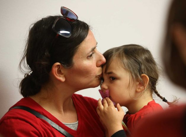 Jessica Damon, of El Cerrito, kisses her daughter, Lucinda Mendes, 3, after leaving a committee hearing where lawmakers approved a measure requiring California schoolchildren to get vaccinated, at the Capitol in Sacramento, Calif., Wednesday, April 22, 2015. The bill, SB277 by Sens. Ben Allen, D-Santa Monica, and Richard Pan, D-Sacramento, was approved by the Senate Education Committee on a 7-2 vote after the authors made amendments that allows families who chose to not vaccinate to homeschool children together and allows independent study. The bill now goes to the Senate Judiciary Committee. (AP Photo/Rich Pedroncelli)