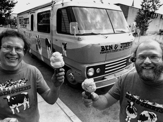 """Jerry Greenfield, left, and Ben Cohen, founders of Ben & Jerry's Homemade Inc., stand in front of their """"Scoopmobile"""" in Burlington, Vt. in 1986 . The founders of Ben & Jerry's Homemade Inc. say the company would not have existed without government resources that would be threatened if Congress repeals the estate tax. (Toby Talbot/AP Photo)"""