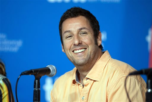 """In this Sept. 6, 2014 file photo, actor Adam Sander smiles during a news conference for """"Men, Women, and Children"""" at the 2014 Toronto International Film Festival in Toronto. A group of American Indian actors have walked off the set of an Adam Sandler movie production following complaints over stereotypes and offensive names. Actor Loren Anthony told The Associated Press on Thursday, April 23, 2015, that he and eight others quit the production of the satirical western """"The Ridiculous Six"""" after producers ignored their concerns about its portrayal of Apache culture. (Hannah Yoon/The Canadian Press via AP, File)"""