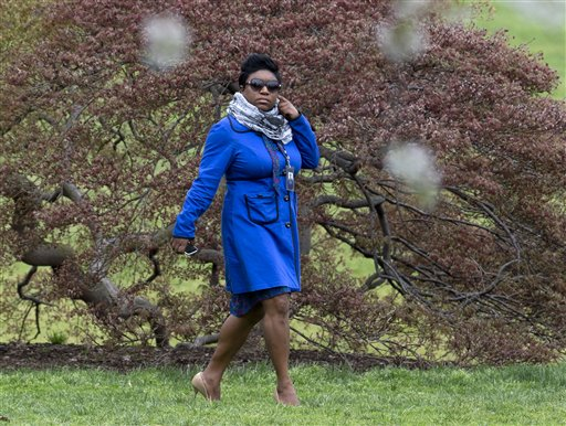 In this photo taken April 15, 2015, Deesha Dyer walks across the South Lawn of the White House in Washington to attend the seventh annual White House Kitchen Garden Planting withfirst lady Michelle Obama. There's a new social director at 1600 Pennsylvania Avenue. The White House announced Thursday that deputy social secretary Deesha Dyer is being promoted to the top job. She will be in charge of planning everything from the annual Easter Egg Roll to opulent state dinners, along with numerous receptions, ceremonies and other events. (AP Photo/Carolyn Kaster)