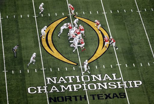 In this Jan. 12, 2015, file photo, Ohio State, right, and Oregon play during the first half of the NCAA college football playoff championship game in Arlington, Texas. According to an NCAA report to be released Tuesday, April 14, 2015, the 39 postseason FBS games distributed $505.9 million to the participating conferences and schools. The schools spent $100.2 million to take part in bowl games. The increase in payouts is due mostly to the increased value of media deals with the seven games, six bowls and a national championship game, that are part of the College Football Playoff. (AP Photo/Tony Gutierrez, File)