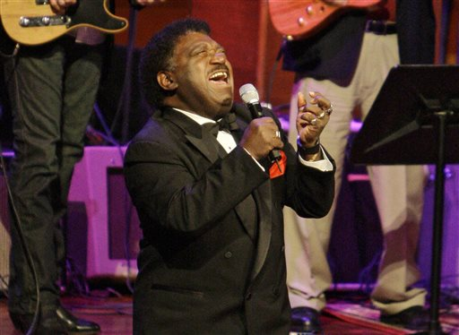 "In this Oct. 28, 2008 file photo, Percy Sledge kneels as he performs ""When a Man Loves a Woman"" along with the Muscle Shoals Rhythm Section at the Musicians Hall of Fame awards show in Nashville, Tenn. Sledge, who recorded the classic 1966 soul ballad ""When a Man Loves a Woman,"" died, Tuesday April 14, 2015. He was 74. (AP Photo/Mark Humphrey, File)"