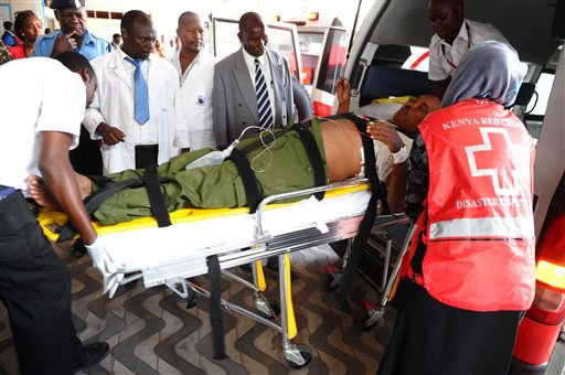 Medics help an injured person at Kenyatta national  Hospital in Nairobi, Kenya, Thursday, April , 2, 2015 , after being airlifted from Garissa after an attack by gunmen at Garissa University College in northeastern Kenya on Thursday morning. Al-Shabab gunmen attacked Garissa University College in northeast Kenya early Thursday, targeting Christians and killing at least 15 people and wounding 60 others, witnesses said. (AP Photo)