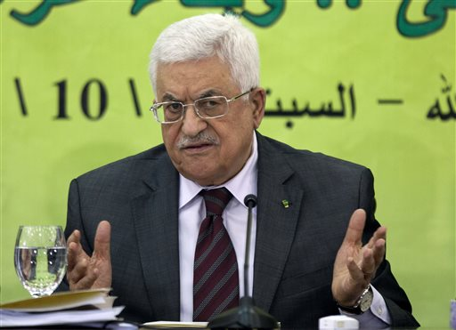 In this Oct. 18, 2014 file photo, Palestinian President Mahmoud Abbas speaks during a meeting of the Fatah revolutionary council in the West Bank city of Ramallah. The Palestinians formally join the International Criminal Court on Wednesday, as part of a broader effort to put international pressure on Israel and exact a higher price for its occupation of lands sought for a Palestinian state. (AP Photo/Majdi Mohammed, File)